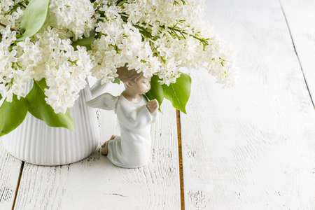 White lilac flowers on wooden table