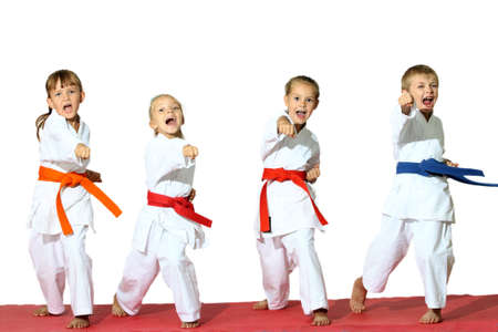 karate boy: Four children in kimono hit a punch  Stock Photo