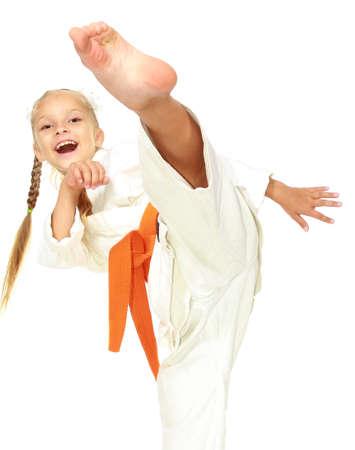 martial art: Sportswoman in white kimono perform a kick