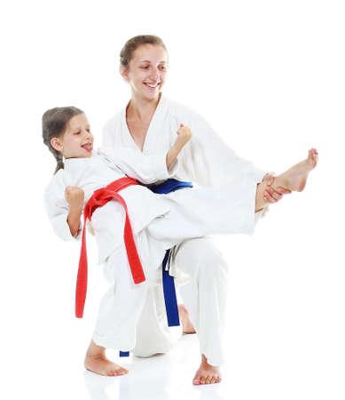 Two sisters, one teaches a sister beat kick leg photo