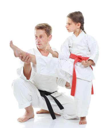 Coach teaches a girl beat kick photo