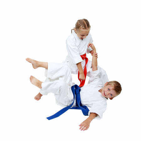 brother sister fight: Girl in a kimono throws the boy in a kimono isolated Stock Photo