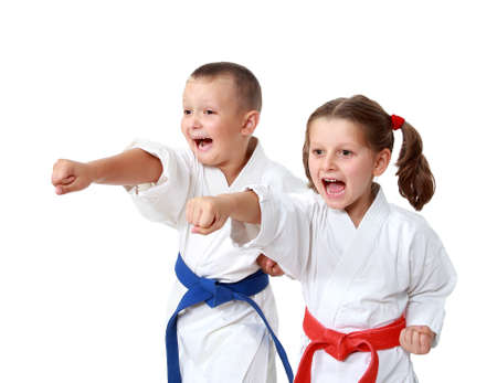 Small children in kimono beat a punch hand on a white background