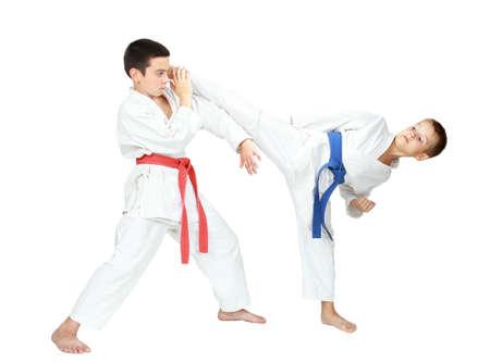 One athlete beat kick leg the second makes the block isolated Фото со стока