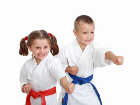 karate: Athletes on a white background beat punch hand
