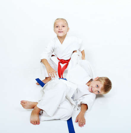 brother sister fight: The girl held a sporty boy  throw