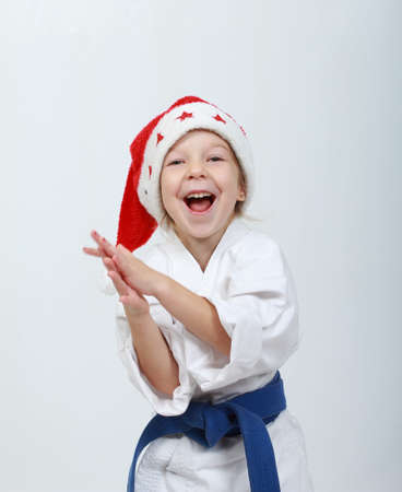 beanie: Cheerful athlete girl  in a kimono and beanie Santa Claus Stock Photo