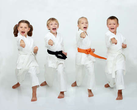Cheerful kids practicing taekwando photo