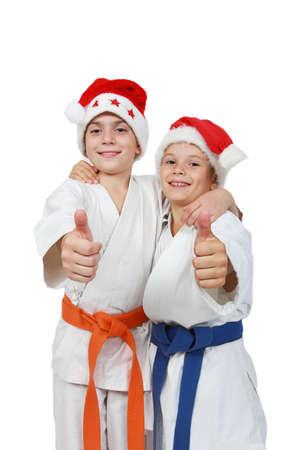 beanies: Dos atletas en la tapa de Santa Claus espect�culo dedo s�per Foto de archivo