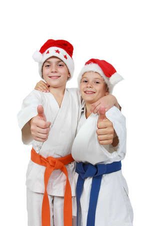 beanies: Two athletes in the cap Santa Claus show finger super Stock Photo