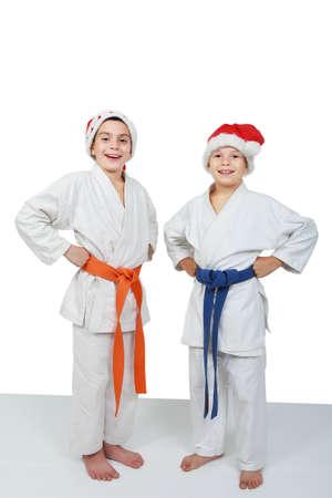 beanies: Dos atletas con gorras de Santa Claus Foto de archivo