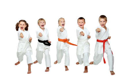 karate kick: In the kimono little kids beat a karate kick arm