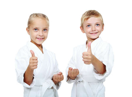 Children athletes with belts show thumb super photo