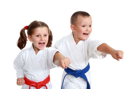 Young athletes in kimono beat a punch arm on a white background photo