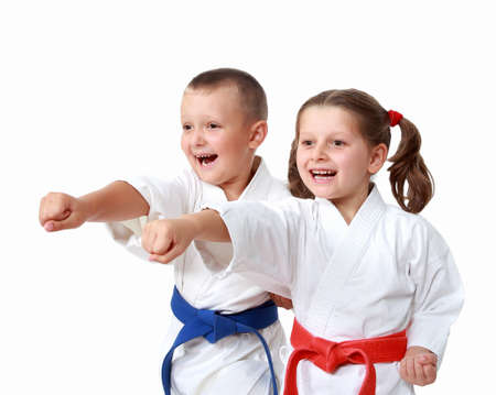 23974745: Happy athletes in a kimono beat punch arm