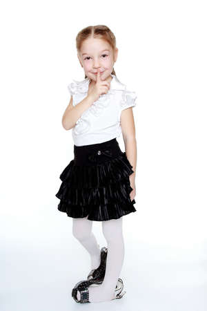 modesty: In her mother s shoes and a white blouse posing little girl