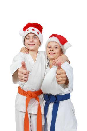 beanies: Dos atletas de la tapa de Santa Claus muestran s�per dedo Foto de archivo