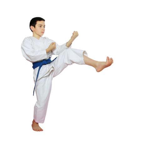 Athlete on a white background beat a kick leg photo