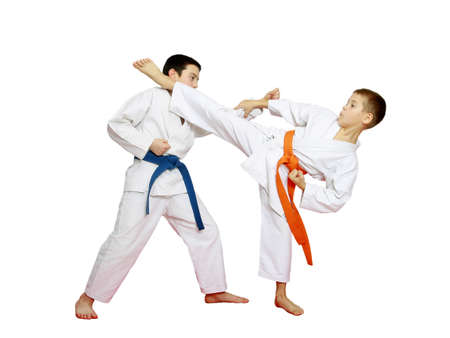 Athletes in kimono are training karate technique