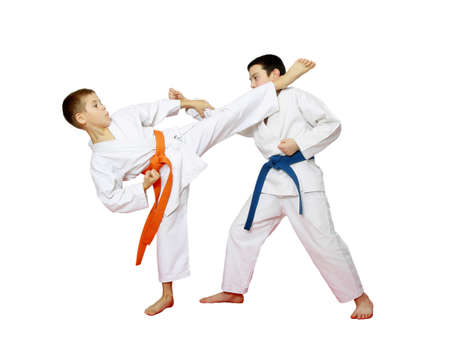 Athletes karate are training paired exercises on a white background photo