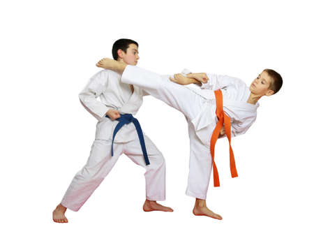 Technique karate in perform athletes with orange and blue belt photo