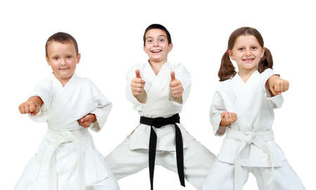 karate boy: Young children express delight of karate lessons Stock Photo