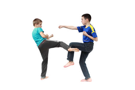 krav maga: In sportswear clothing two boys are training techniques