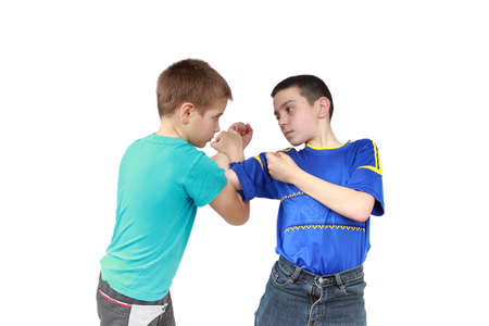 krav maga: On a white background two boys in sportswear clothing is performing tricks