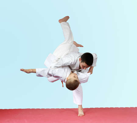Throws judo two athletes are training on the mat Фото со стока