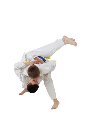 High throw judo are training boys in white kimono