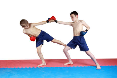 krav maga: Boy in shorts and red lining hit low kick other
