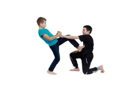 krav maga: Two boys in T-shirts are doing methods of pain