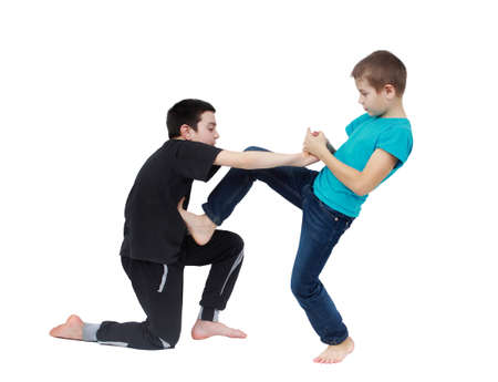 In the blue T-shirt boy is doing armlock on a boy in a black T-shirt