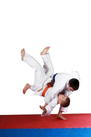 jiu jitsu: On the red and blue mat boys are training throw