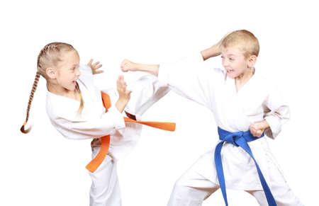 taekwondo: Children in karategi are beating kicks and hand
