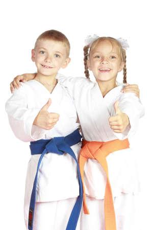In karategi Athleten zeigen Daumen Super Lizenzfreie Bilder