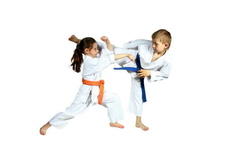 jiu jitsu: Girl and boy in karategi are training paired exercises karate