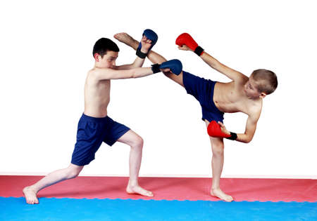 krav maga: boys are doing paired exercises on red and blue linings