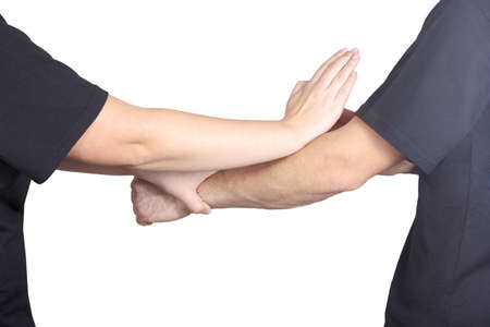 chun: Punch arm and block of Wing Chun kung fu are doing athletes do Stock Photo