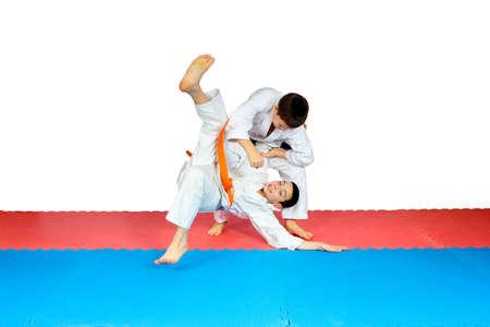 throws: Throws judo perfoming athletes in judogi