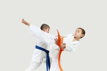 jiu jitsu: Sports kids are performing in paired exercises karate