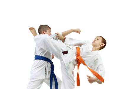 jiu jitsu: Young athletes paired exercises karate Stock Photo