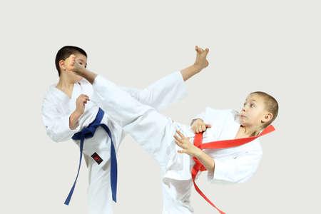 jiu jitsu: High blows legs are beat sportsmens in karategi