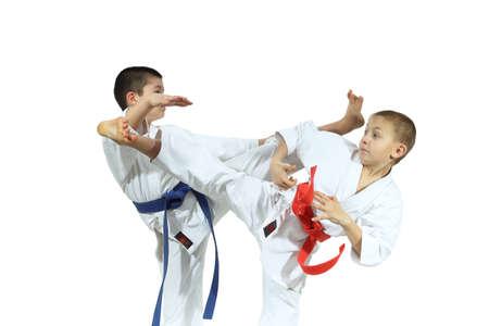 jiu jitsu: Two sportsman are training beat high kicks