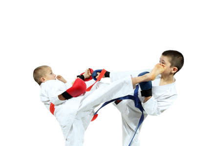 overlays: Boys in sporting overlays are training paired exercises karate Stock Photo