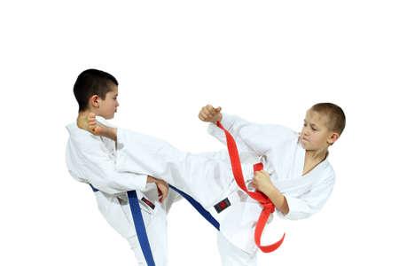 jiu jitsu: Boys in karategi are beat blows kicks Stock Photo