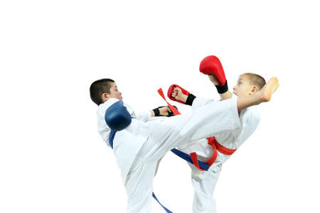 overlays: Young athletes with overlays on hands are training blows legs