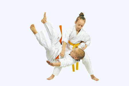 Sportswoman with a yellow belt is makes throw Judo