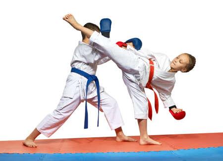 judo: Athletes are training  beat Ura mavashi geri and protection against it Stock Photo