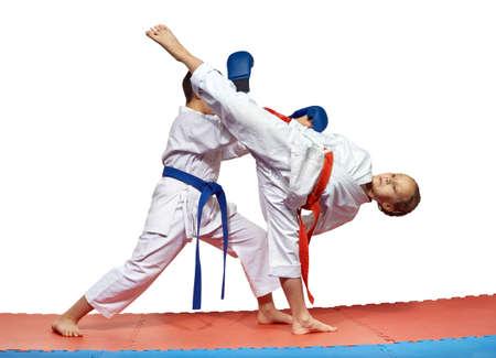 thai arts: Blow Ura mavashi geri and protection from him are training athletes in karategi